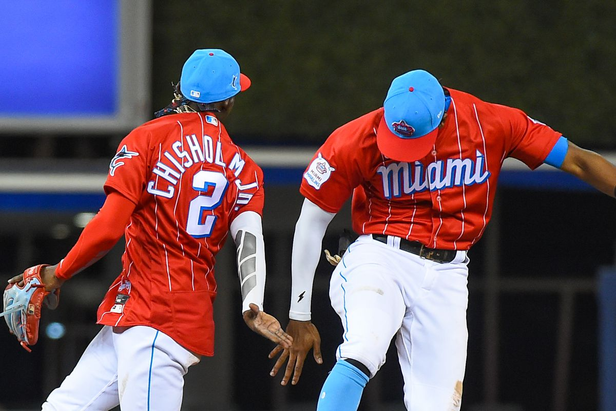Lewis Brinson #25 and Jazz Chisholm Jr. #2 of the Miami Marlins celebrate after defeating the against the Chicago Cubs at loanDepot park