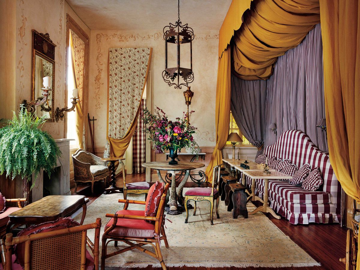 A fancy hotel with draperies, huge pendant lights, high ceilings, and antiques