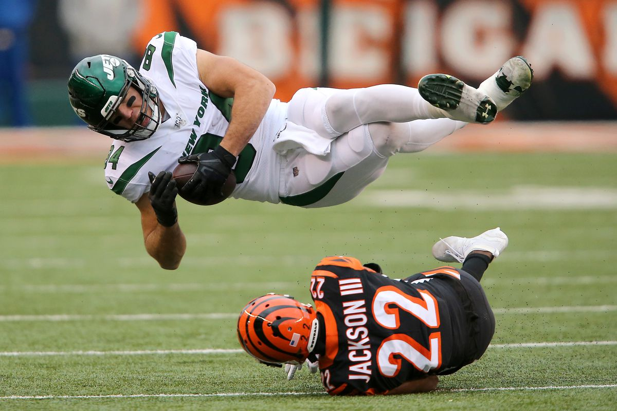 New York Jets tight end Ryan Griffin is tackled after the after catch by Cincinnati Bengals cornerback William Jackson defends during the second quarter at Paul Brown Stadium.