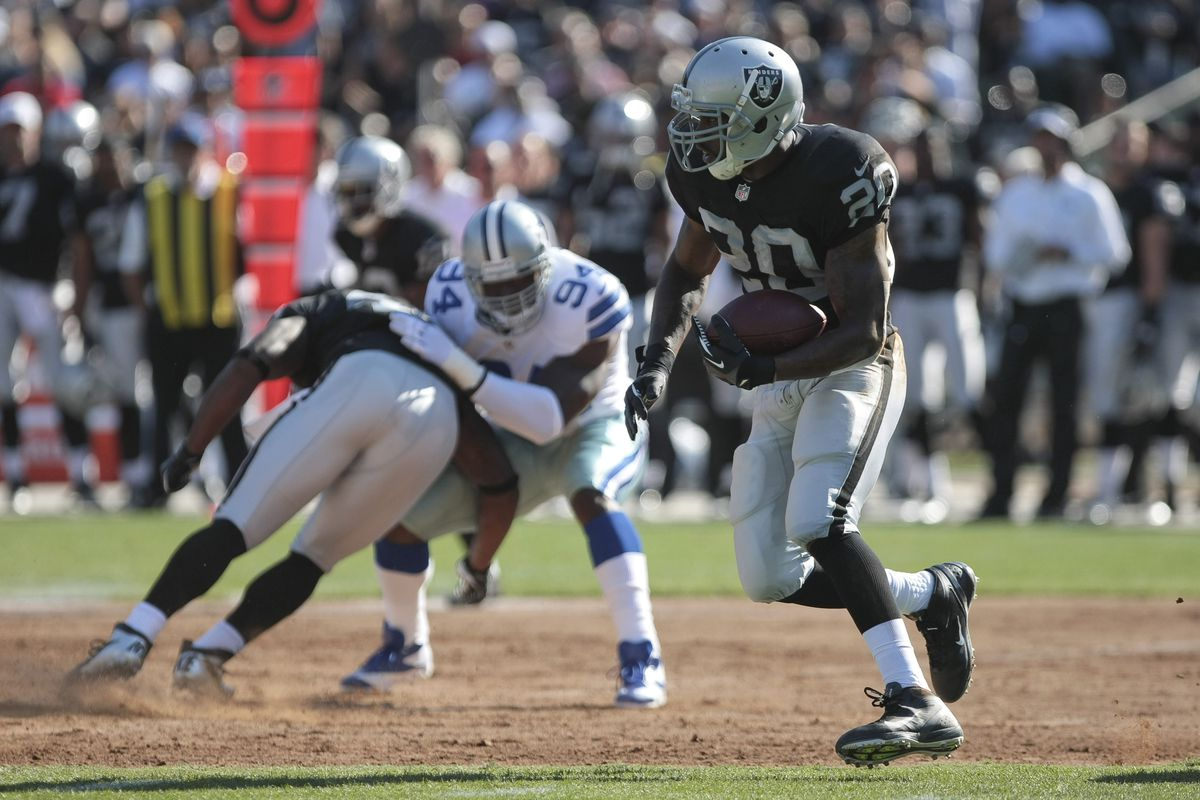 August 13, 2012; Oakland, USA; Oakland Raiders running back Darren McFadden (20) carries the ball against the Dallas Cowboys during the first quarter at O.co Coliseum. Mandatory Credit: Kelley L Cox-US PRESSWIRE