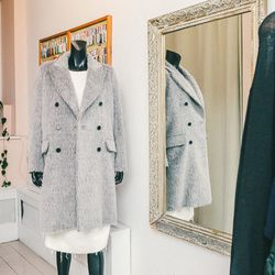 """On mannequin: Defect 'Tallulah' long coat in silver gray, <a href=""""http://no6store.com/categories/outerwear/defect-tallulah-long-coat-in-silver-grey.html"""">$675</a>; Black Crane quilted dress in creme, <a href=""""http://no6store.com/new-designers/black-crane"""