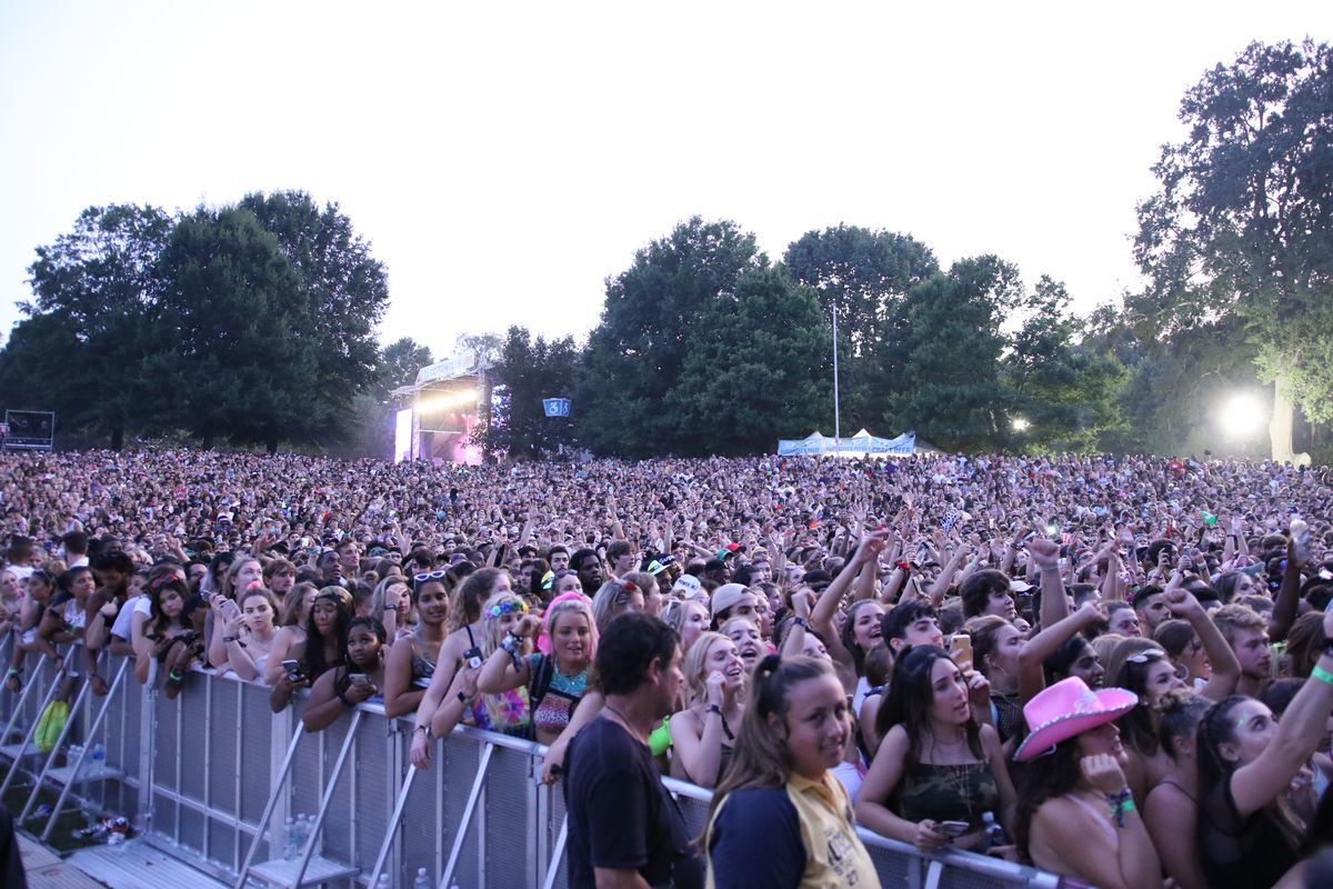 Lizzo's crowd stretches nearly to the next stage.