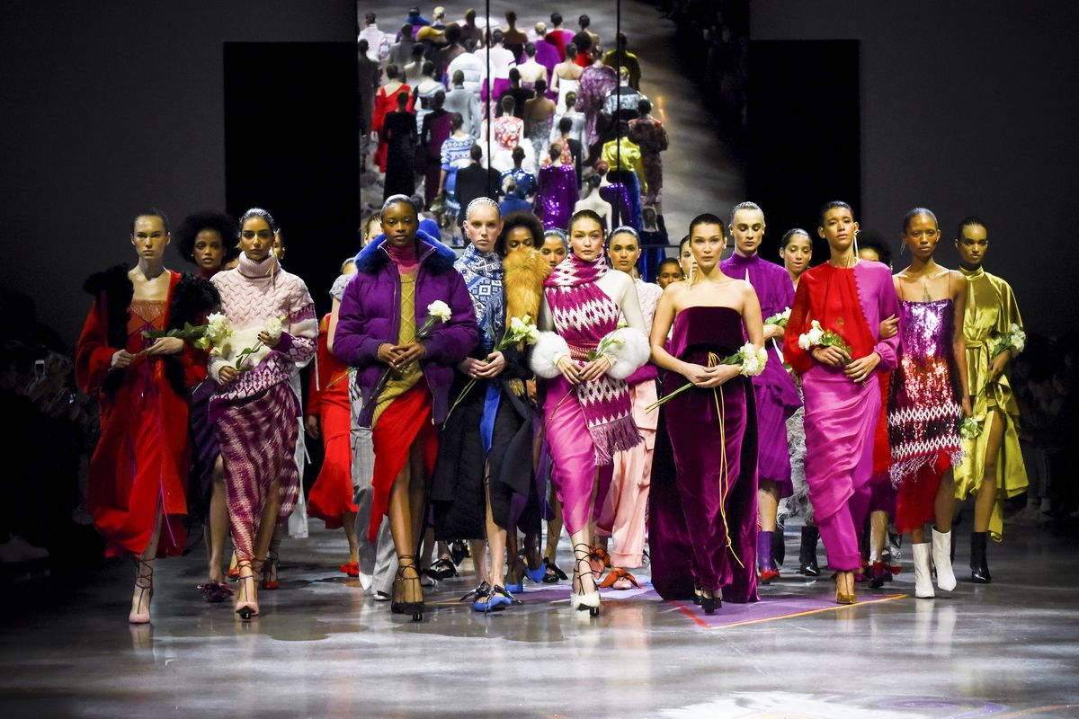 Models hold white roses during the finale of Prabal Gurung's fall 2018 show on Sunday.