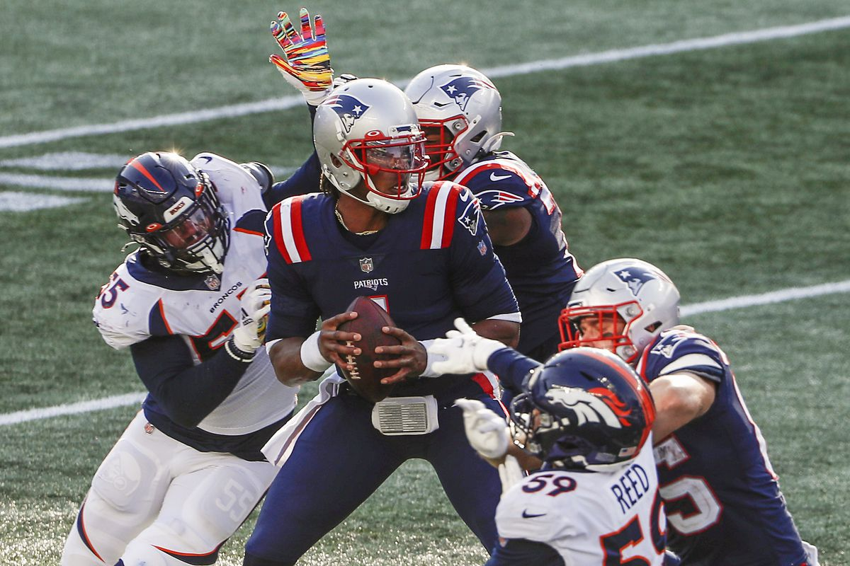New England Patriots quarterback Cam Newton (1) drops back to pass under pressure from Denver Broncos linebacker Bradley Chubb (55) and linebacker Malik Reed (59) during the second half at Gillette Stadium.
