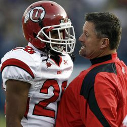Utah head coach Kyle Whittingham gets into Utah defensive back Reggie Topps after he had an unsportsmanlike call against him as BYU and Utah play at LaVell Edwards Stadium Saturday in Provo. BYU won in overtime, 26-23.
