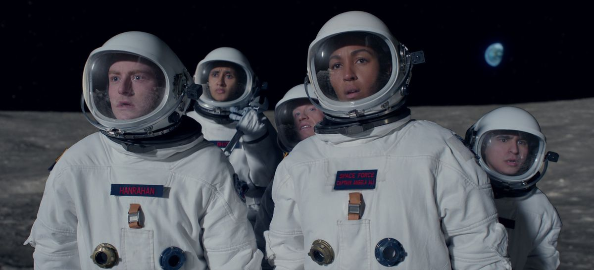 a group of astronauts look confused