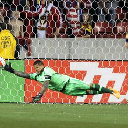 Real Salt Lake goalkeeper Nick Rimando (18) makes a diving save during a game at Rio Tinto Stadium in Sandy on Saturday, March 29, 2014.