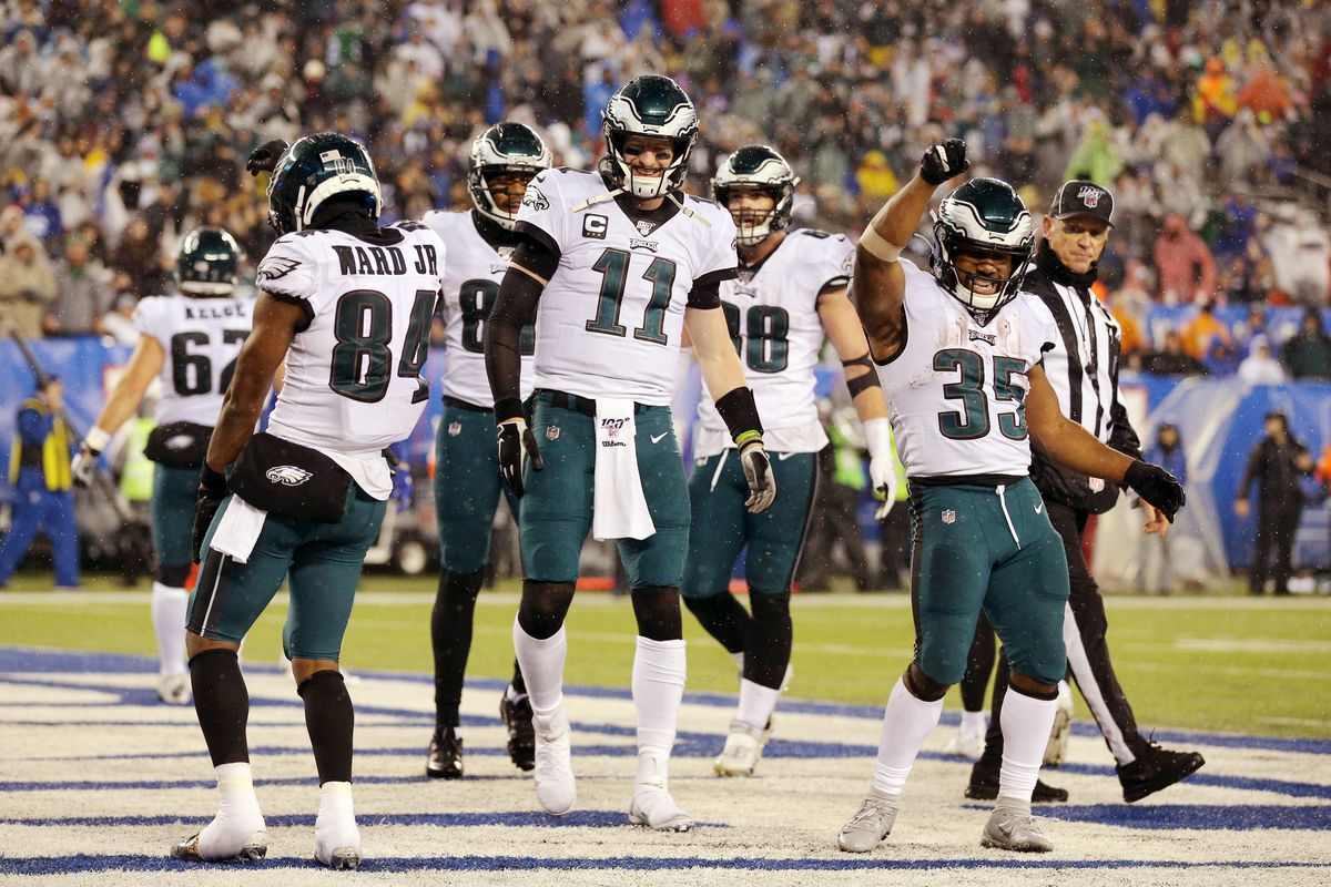Philadelphia Eagles running back Boston Scott celebrates his touchdown against the New York Giants with wide receiver Greg Ward Jr. and quarterback Carson Wentz during the third quarter at MetLife Stadium.