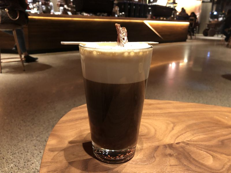 Nitro cold brew with peppercorn foam and beef jerky