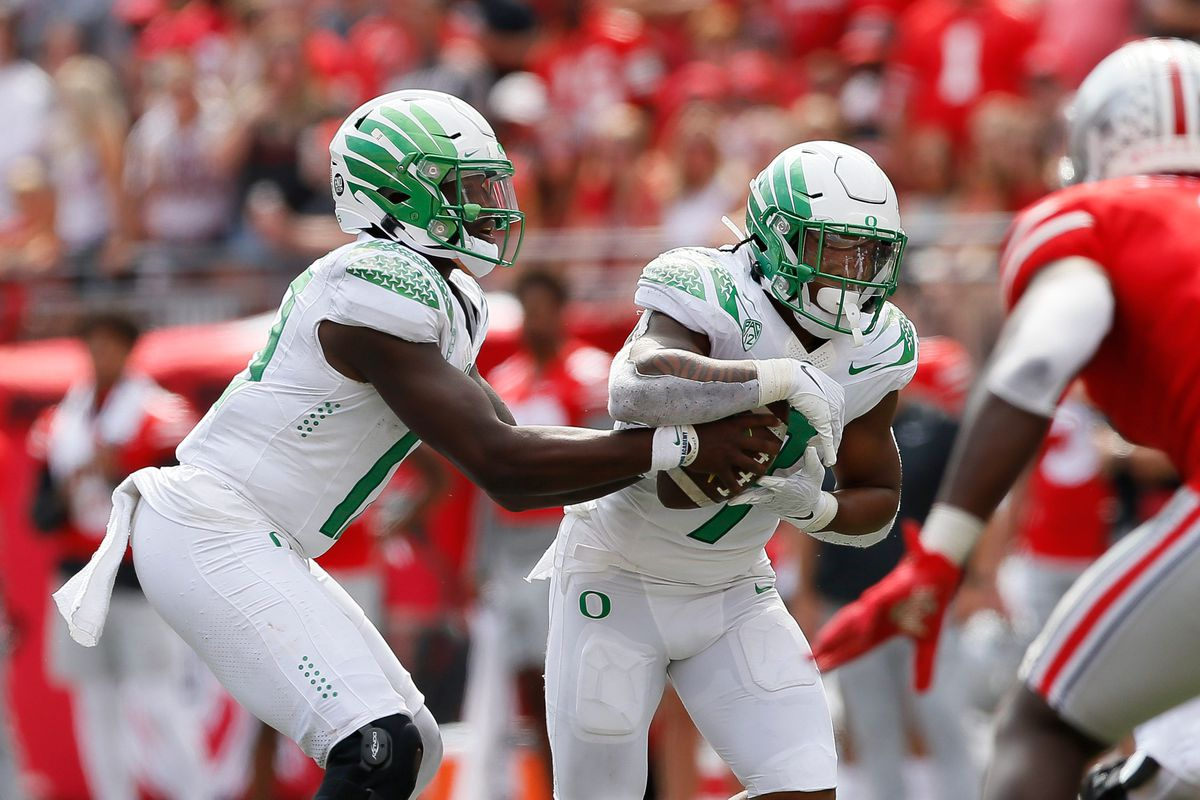 Oregon Ducks quarterback Anthony Brown hands off to running back CJ Verdell during the fourth quarter of the NCAA football game at Ohio Stadium in Columbus on Saturday, Sept. 11, 2021.