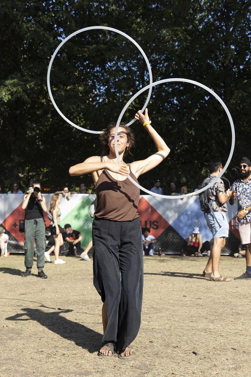 A festival-goer dances with hoops at Pitchfork Music Festival, Friday, Sept. 10, 2021.