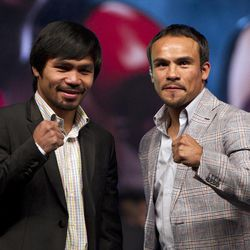 WBO welterweight champion boxer Manny Pacquiao, of the Philippines, left, poses for photos next to his challenger Juan Manuel Marquez, of Mexico, during a news conference in Mexico City, Friday, Sept. 21, 2012. The boxers are promoting their fourth fight, scheduled for Dec. 8, 2012 in Las Vegas.