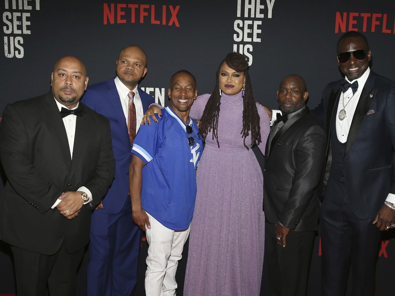 """Director Ava DuVernay with the Central Park 5 (from left): Raymond Santana, Kevin Richardson, Korey Wise, Anthony McCray and Yuesf Salaam at the premiere of """"When They See Us"""" at the Apollo Theater in New York."""