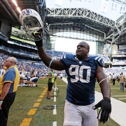 Indianapolis Colts' Cory Redding (90)  gestures as he leaves the field after the Colts defeated the Minnesota Vikings 23-20 in an NFL football game in Indianapolis, Sunday, Sept. 16, 2012.