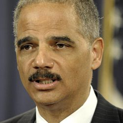 Attorney General Eric Holder speaks during a news conference at the Justice Department in Washington, Wednesday, April 11, 2012. The Justice Department and several states have sued Apple Inc. and major book publishers, alleging a conspiracy to raise the price of electronic books that Attorney General Eric Holder says cost consumers millions of dollars.