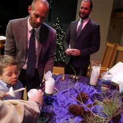 Jesse Milner-Barraza, 4, lights a candle during the wedding ceremony of his parents, Tony Milner and Matt Barraza, at the United Church of Christ in Holladay on Friday, Dec. 20, 2013. Barraza and Milner have been together for 11 years and have been raising Jesse since the day he was born.