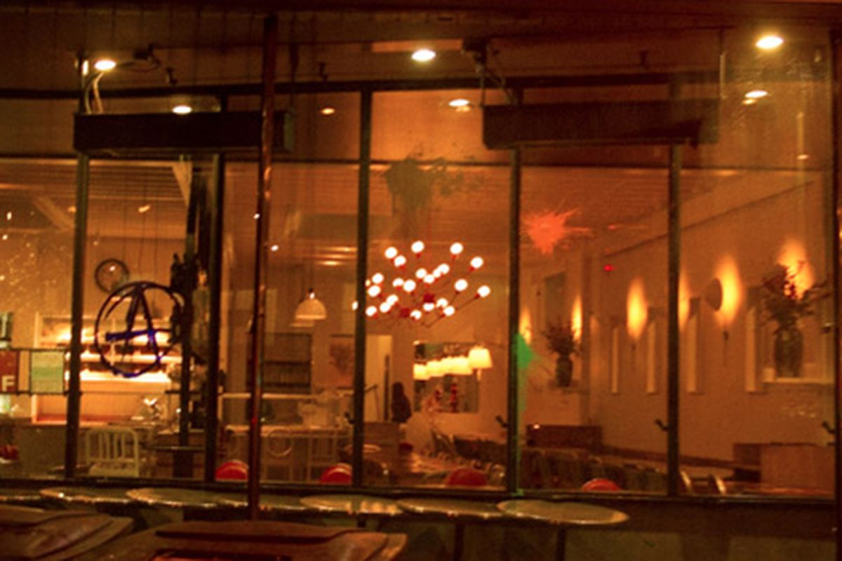 An anarchy symbol was painted on Farina restaurant during last night's group protest.