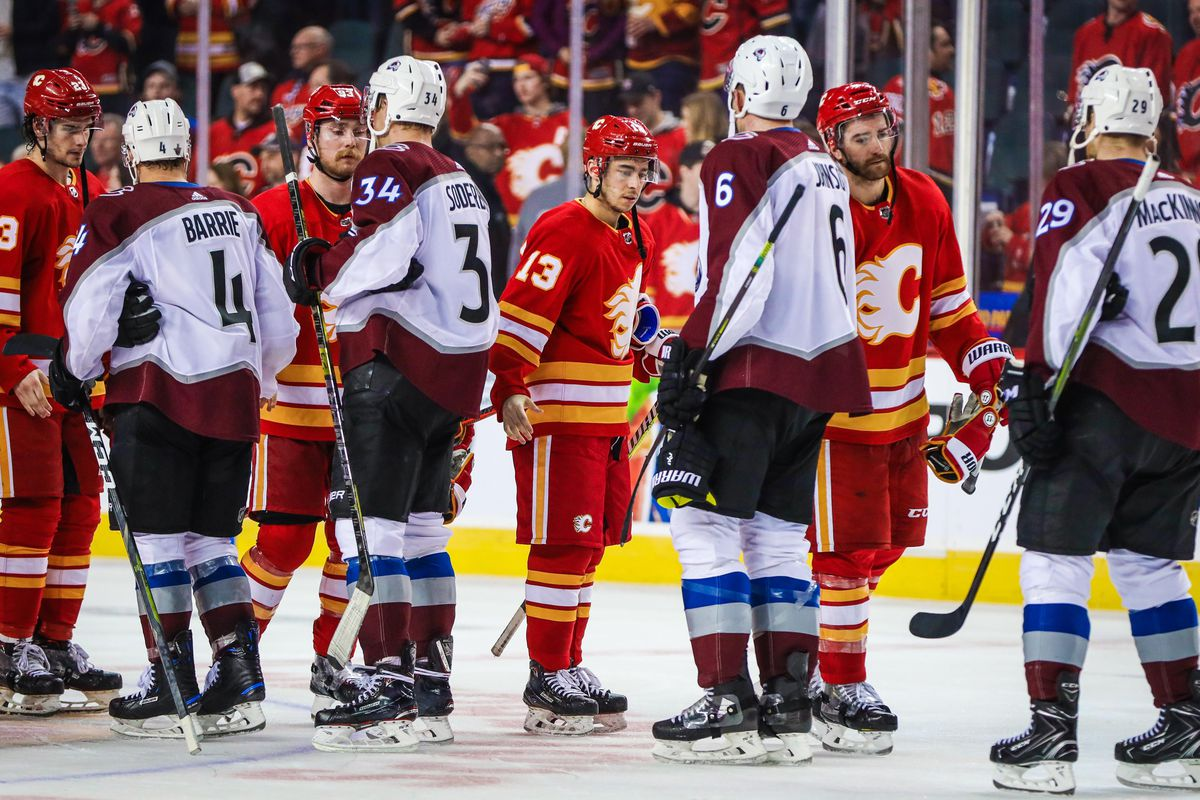 Apr 19, 2019; Calgary, Alberta, CAN; Calgary Flames left wing Johnny Gaudreau (13) shaking hands with Colorado Avalanche players after the game in game five of the first round of the 2019 Stanley Cup Playoffs at Scotiabank Saddledome. Colorado Avalanche w