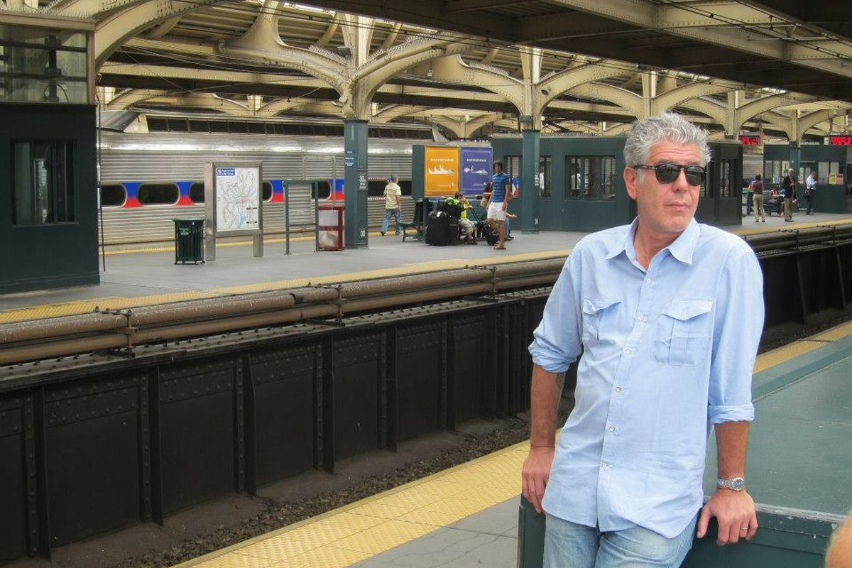 Bourdain hanging out, waiting for a late SEPTA train.