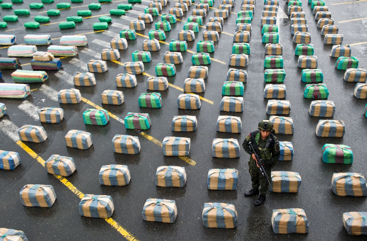 A soldier stands by seized drugs in Colombia.
