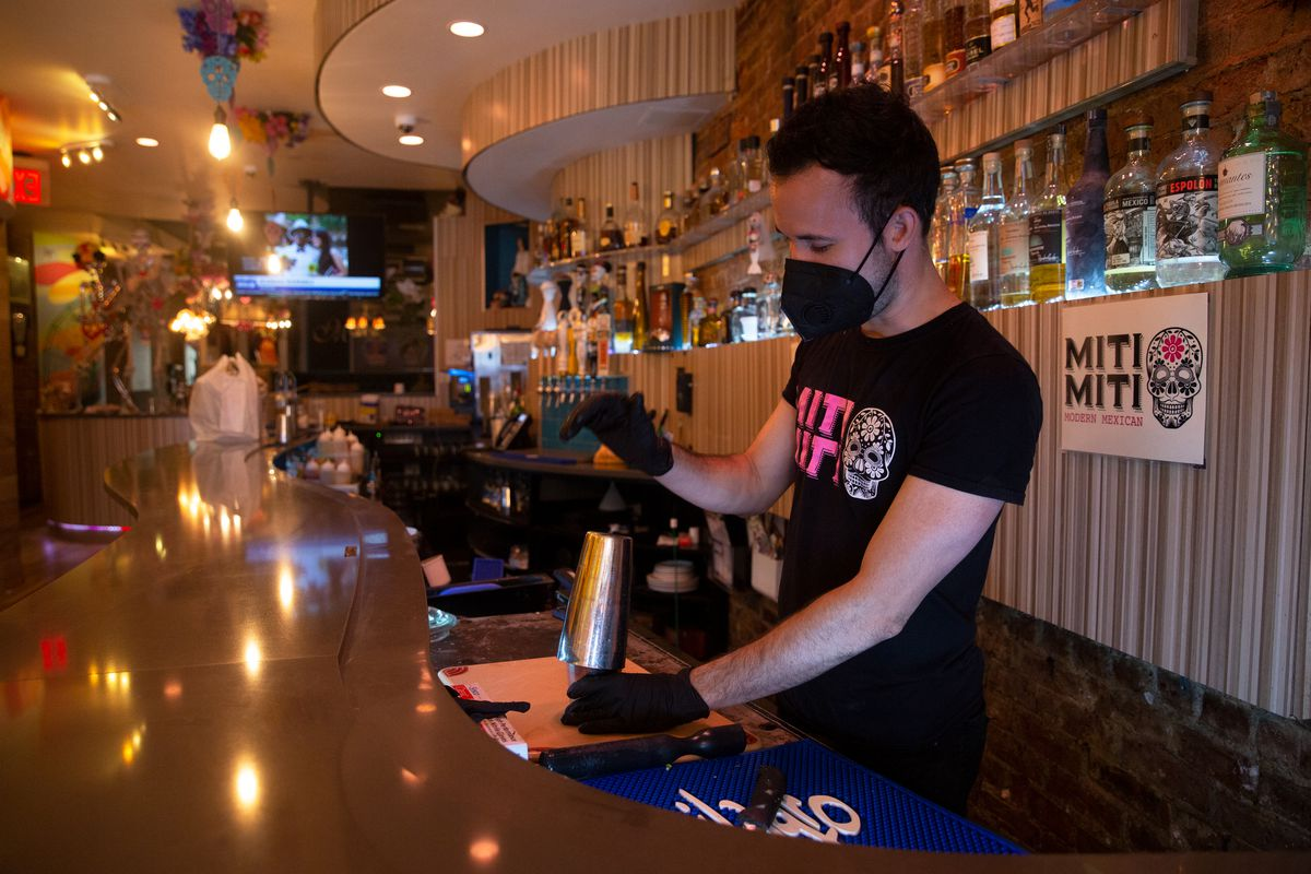 Ernesto Sarmiento makes a drink at Miti Miti in Park Sloper after returning to work after quarantining for several months, June 19, 2020.