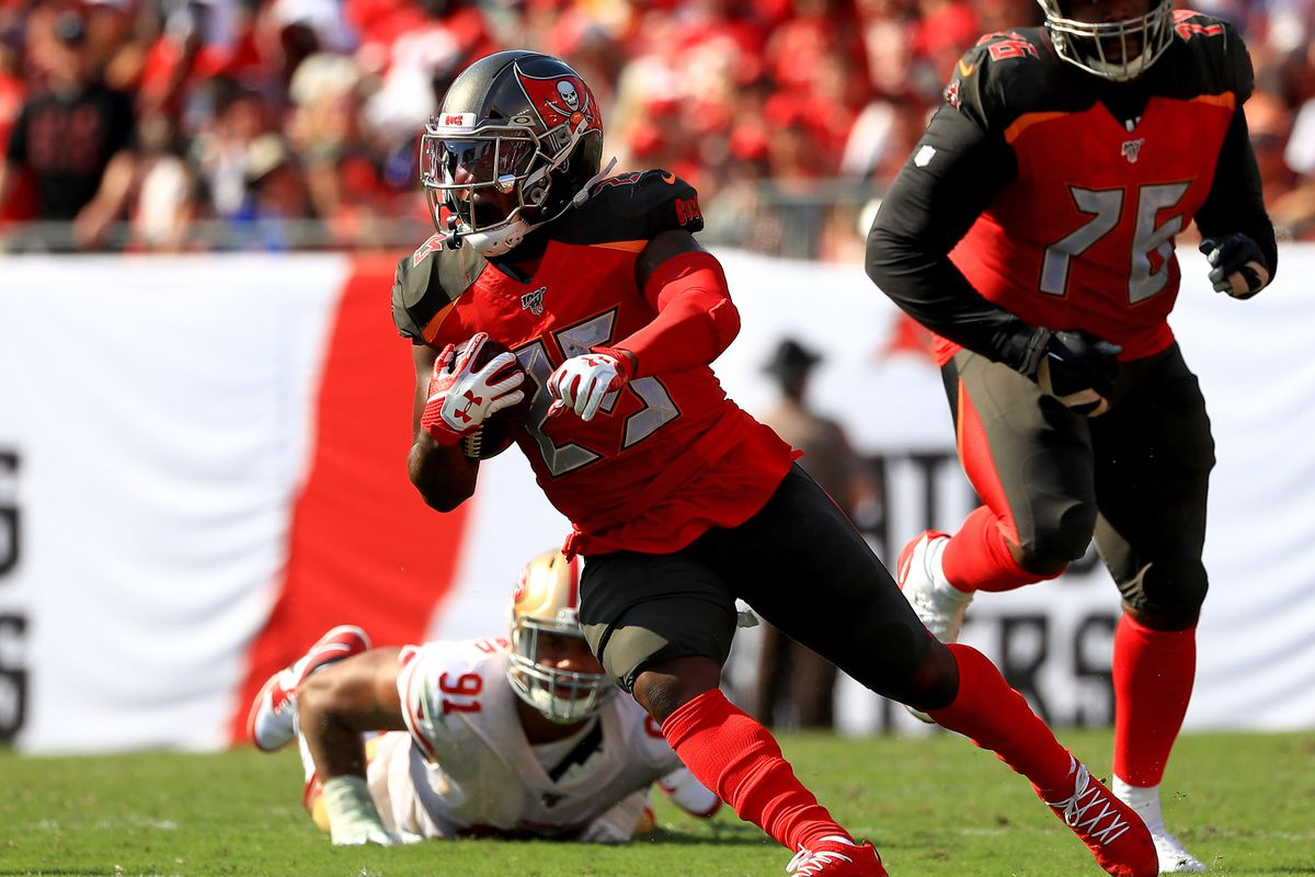 Peyton Barber of the Tampa Bay Buccaneers rushes during a game against the San Francisco 49ers at Raymond James Stadium on September 08, 2019 in Tampa, Florida.