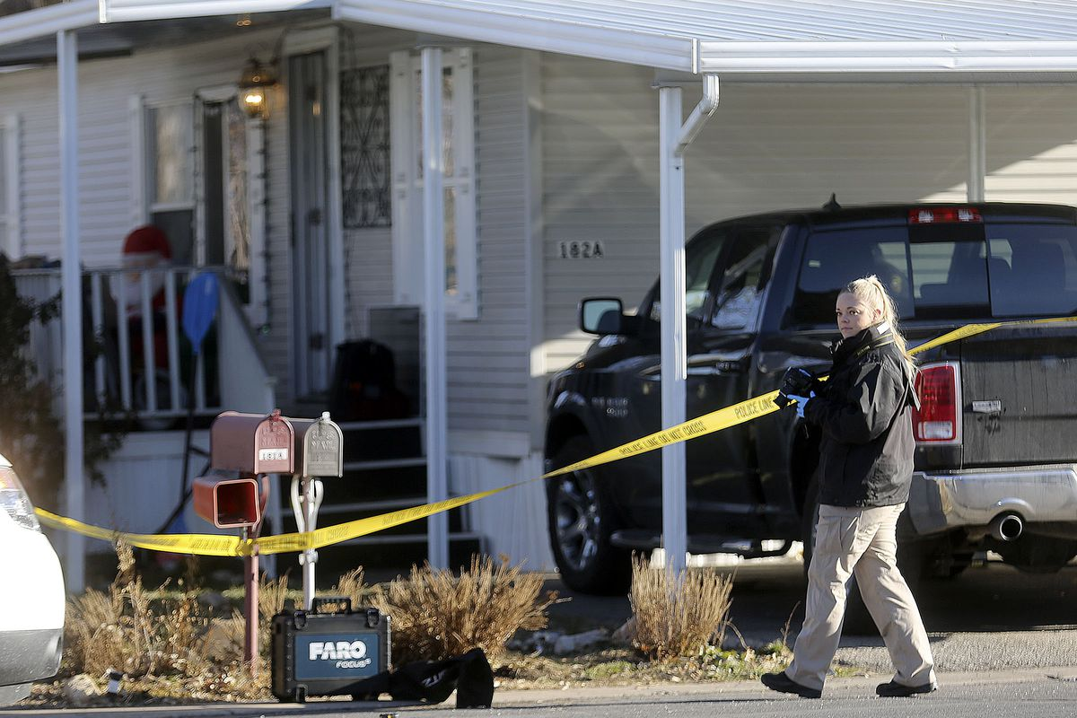 A Weber Metro CSI unit photographer works at the scene of a fatal shooting that occurred early Christmas morning in Riverdale, Weber County, on Friday, Dec. 25, 2020.