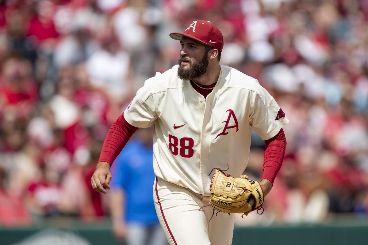 Zebulon Vermillion of the Arkansas Razorbacks throws a pitch during a game against the Florida Gators at Baum-Walker Stadium at George Cole Field on May 22, 2021 in Fayetteville, Arkansas. The Razorbacks defeated the Gators to sweep the series 9-3.