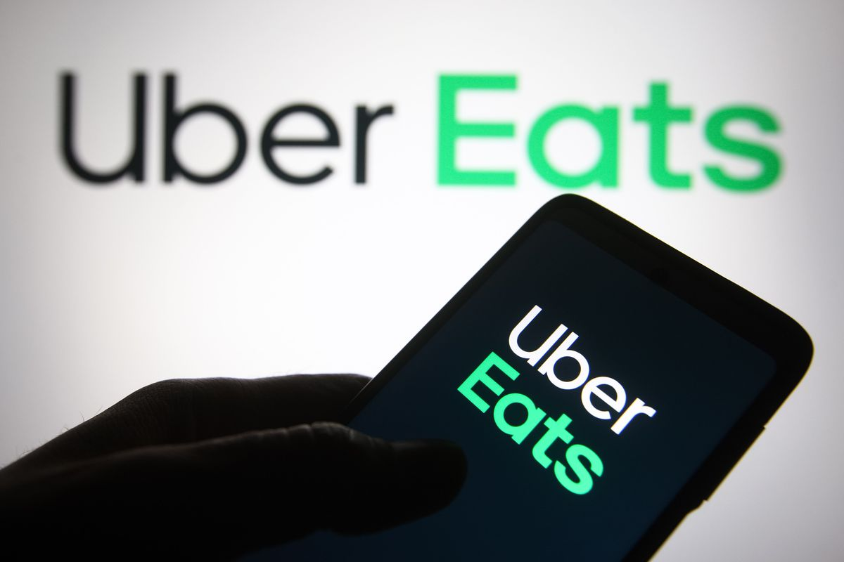 In this photo illustration, Uber Eats logo of a US online...