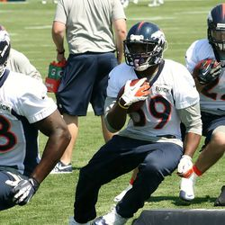 (From L to R) Montee Ball, CJ Anderson and Jacob Hester make cuts through the pads