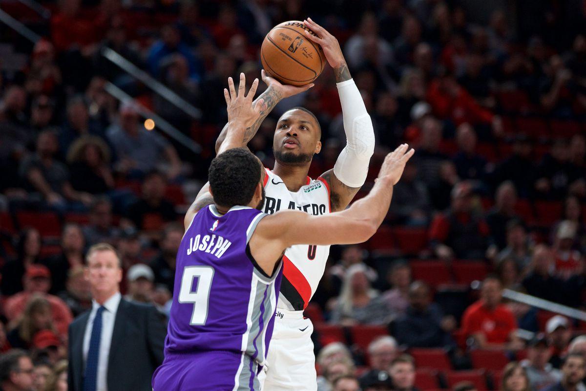 Portland Trail Blazers guard Damian Lillard shoots over Sacramento Kings guard Cory Joseph during the first quarter at the Moda Center.