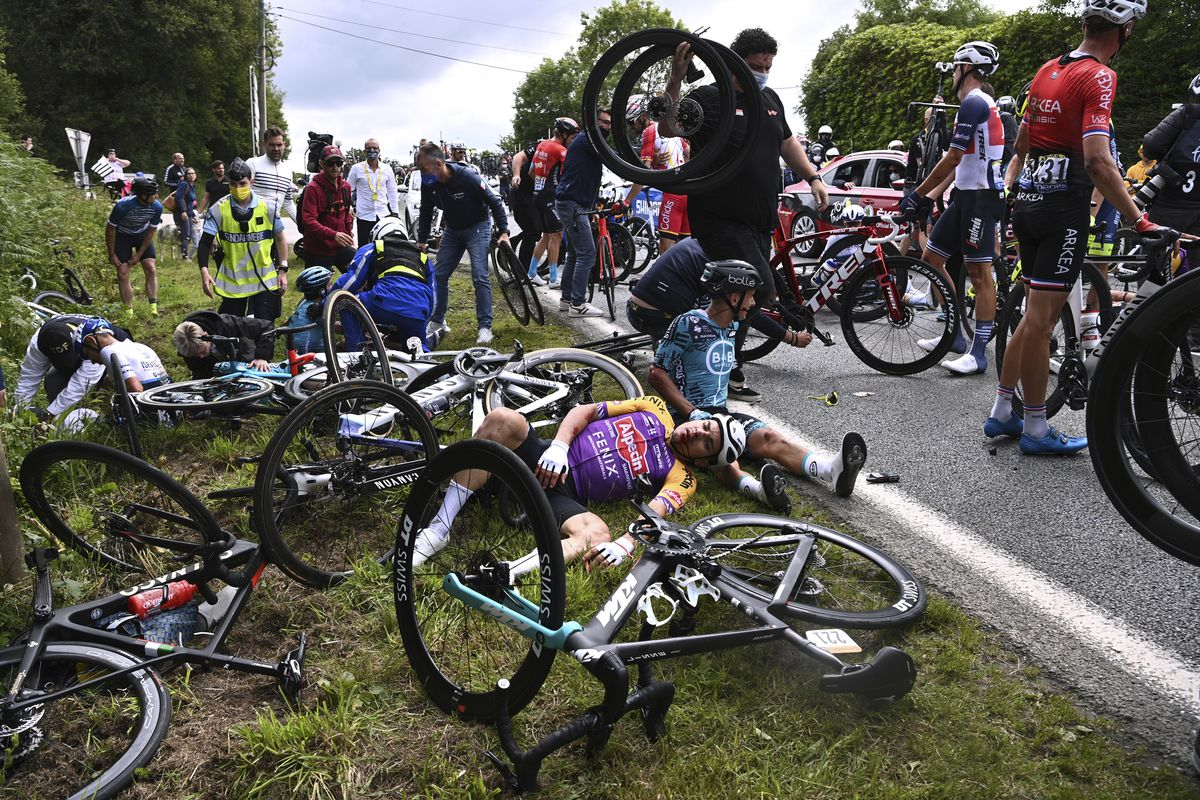 Italy's Kristian Sbaragli, left, and France's Bryan Coquard, right, lie on the ground after crashing during the first stage of the Tour de France.