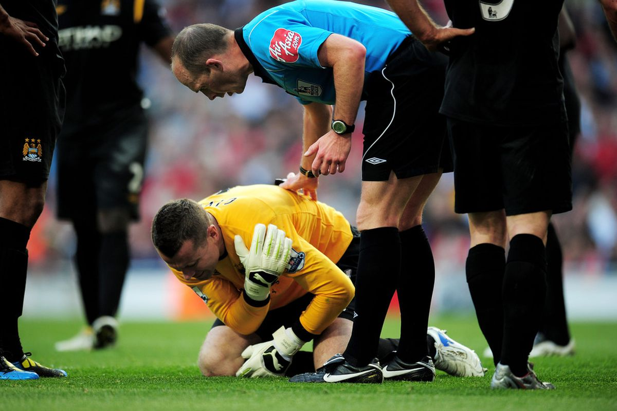 An injured Shay Given awaits treatment during yesterday's goalless draw at The Emirates against Arsenal. (Picture from getty images)