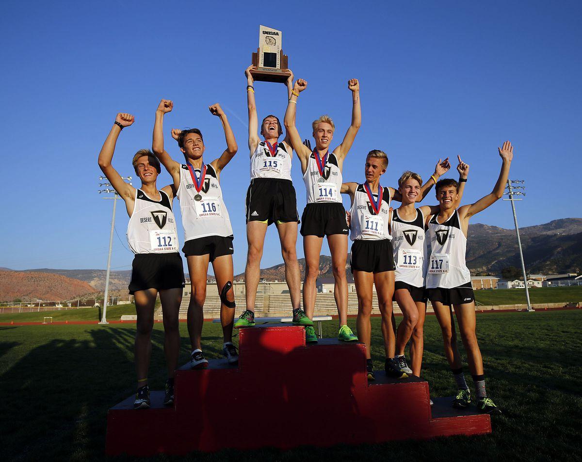 Desert Hills High School team celebrates winning the 4A state boys high school cross-country championship in Cedar City on Wednesday, Oct. 21, 2020.
