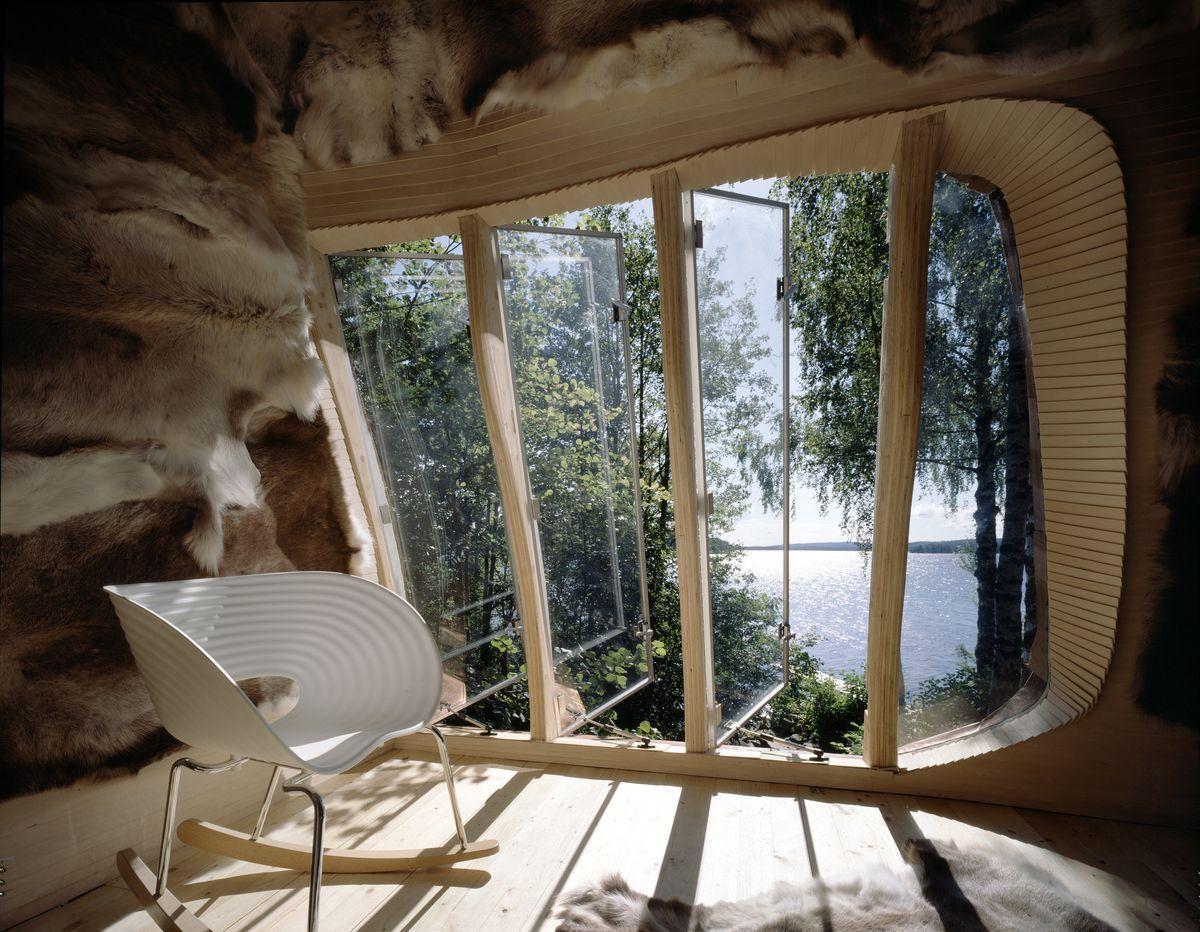 Rocking chair sitting next to large window
