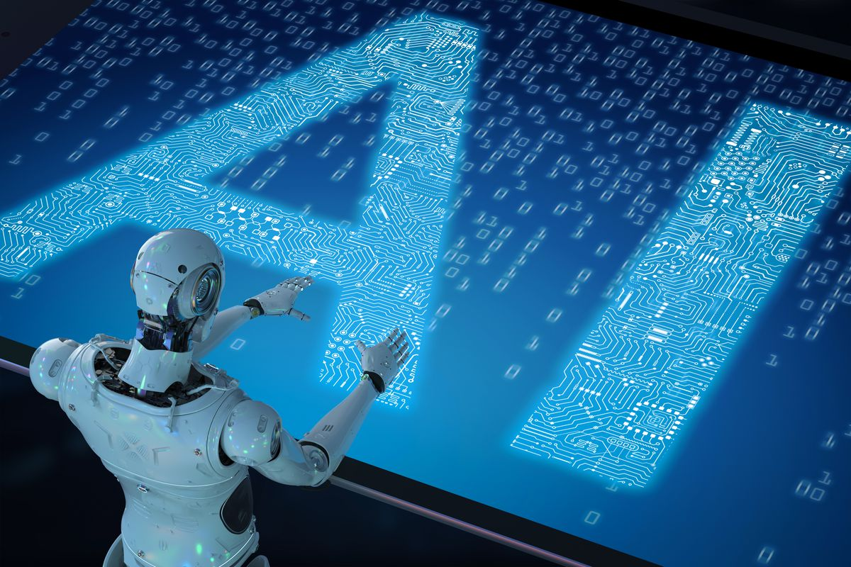"A humanoid robot stands in front of a screen displaying the letters ""AI."""