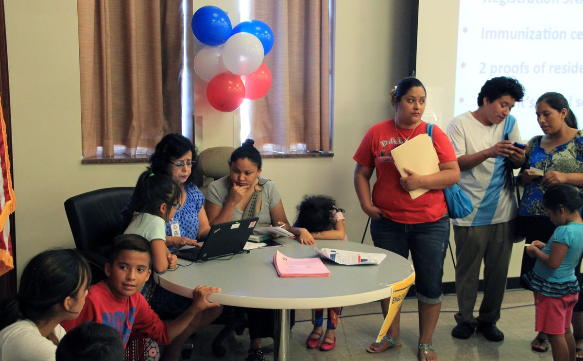 Parents seek assistance from district translator Silvia Cubillos.