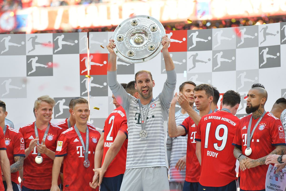 MUNICH, GERMANY - MAY 12: Goalkeeper Tom Starke of Muenchen celebrates winning the championship after the Bundesliga match between FC Bayern Muenchen and VfB Stuttgart at Allianz Arena on May 12, 2018 in Munich, Germany.