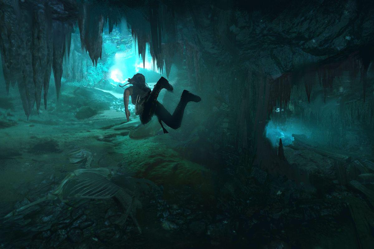 Shadow of the Tomb Raider - Lara swimming through a cave