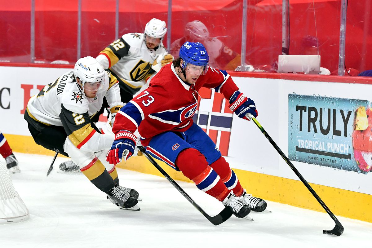 Tyler Toffoli #73 of the Montreal Canadiens is defended by Zach Whitecloud #2 of the Vegas Golden Knights during the second period in Game Four of the Stanley Cup Semifinals of the 2021 Stanley Cup Playoffs at Bell Centre on June 20, 2021 in Montreal, Quebec.