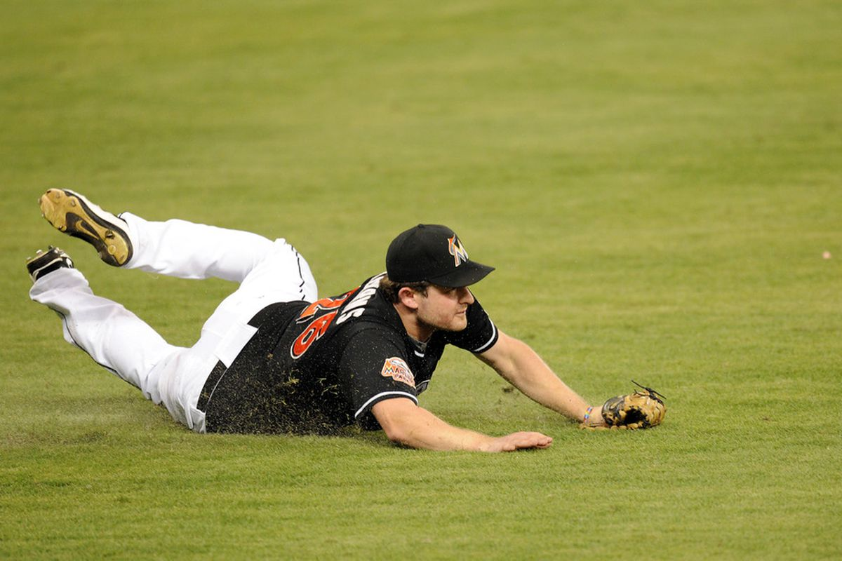 May 11, 2012; Miami, FL, USA; Miami Marlins left fielder Austin Kearns (26) is unable to field a base hit by New York Mets right fielder Lucas Duda (not pictured) during the sixth inning at Marlins Park. Mandatory Credit: Steve Mitchell-US PRESSWIRE