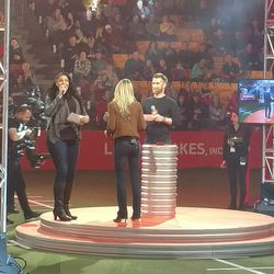 Jordin Sparks, Allie LaForce, and Marty Smith addressing the crowd.