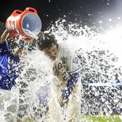 Salvador Perez dumps water on Adalberto Mondesi to celebrate a win over the Indians.