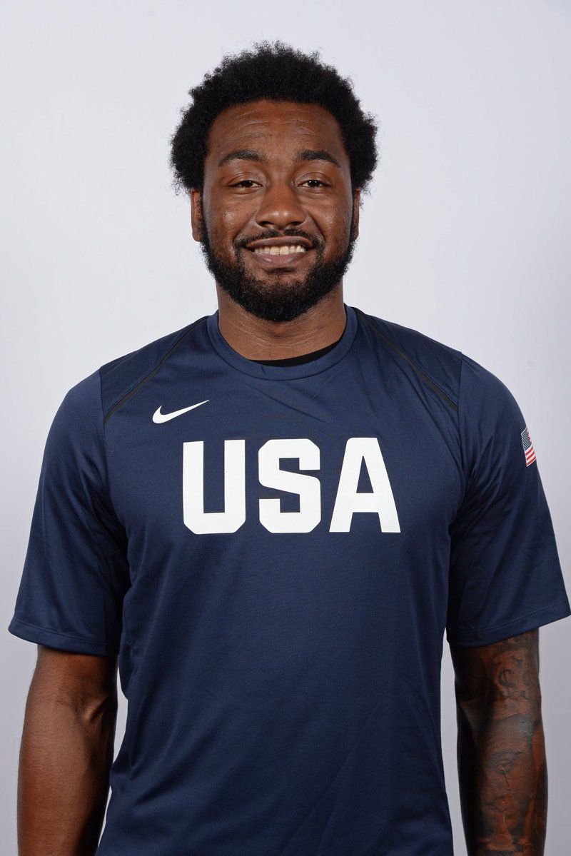 John Wall's Team USA headshot, in which he's squinting and awkwardly smiling