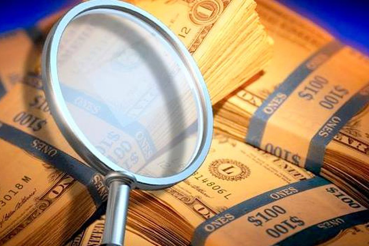 Illustration of cash and magnifying glass