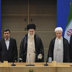 In this photo taken on Thursday, Aug. 30, 2012, and released by the official website of the Iranian supreme leader's office, supreme leader Ayatollah Ali Khamenei, center, parliament speaker Ali Larijani, right, chief of Expediency Council, Akbar Hashemi Rafsanjani, second right, President Mahmoud Ahmadinejad, second left, and judiciary chief Sadeq Larijani, left, listen to Iran's national anthem, at the opening session of the Nonaligned Movement, NAM, summit, in Tehran, Iran.