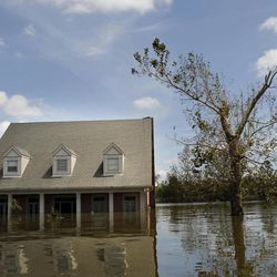 A flooded home from Hurricane Isaac is seen in Braithwaite, La., Saturday, Sept. 1, 2012. While New Orleans streets were bustling again and workers were returning to offshore oil rigs, thousands of evacuees couldn't return home to flooded low-lying areas of Louisiana and more than 400,000 sweltering electricity customers in the state remained without power.