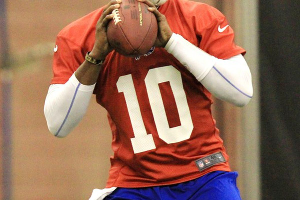 May 29, 2012; Orchard Park, NY, USA; Buffalo Bills quarterback Vince Young (10) passes during organized team activities at Ralph Wilson Field House. Mandatory Credit: Kevin Hoffman-US PRESSWIRE