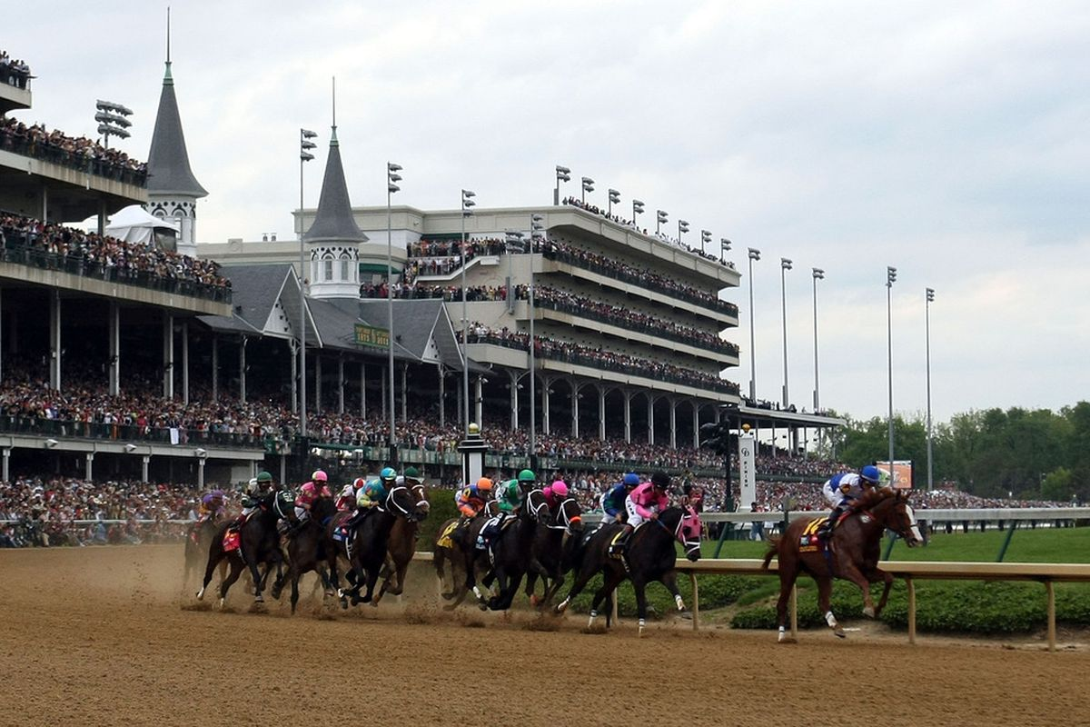 LOUISVILLE, KY - MAY 07:  Jockey Jesus L. Castanon (R), riding Shackleford #14, leads the field through turn one during the 137th Kentucky Derby at Churchill Downs on May 7, 2011 in Louisville, Kentucky.  (Photo by Al Bello/Getty Images)