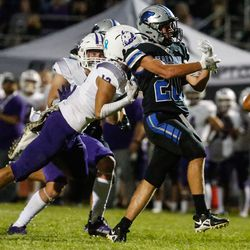 Stansbury's Dylan Hamilton (20) misses a pass while getting pressured by Tooele during a high school football gameat Stansbury High School in Stansbury Park on Friday, Sept. 17, 2021.